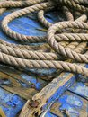 detail ship blue . Object weathered wood and rope Royalty Free Stock Photo