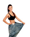Objective achieved woman at her ideal weight slim with huge pants isolated on white background Stock Images