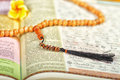 Objects holy quran and pray beads close up Stock Photography