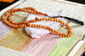 Objects holy quran and pray beads close up Royalty Free Stock Photography