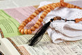 Objects holy quran and pray beads close up Stock Photo