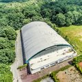 Oblique aerial view of an old tennis and soccer hall Royalty Free Stock Photo