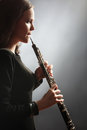 Oboe player oboist playing music instrument Royalty Free Stock Photo