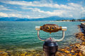 Observation binocular retro telescope for magnifying view of lake and mountains Royalty Free Stock Image