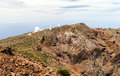 Observatory astronomy telescope in mountains on la palma canary islands telescopic equipment over cloudy sky on mountain peak Stock Photo
