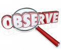 Observe d word magnifying glass examine inspect pay attention in red letters under a to illustrate the need to and the details of Royalty Free Stock Photo