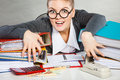 Obsessed female clerk at work. Royalty Free Stock Photo