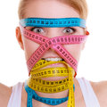 Obsessed sporty fit woman with measure tapes. Time for diet slimming. Stock Photography