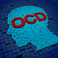 Obsessive compulsive disorder or ocd medical concept as a human head and letters made of organized three dimensional cubes as a Stock Image
