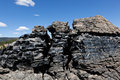 Obsidian lava flow a large formation of black cracked by weather and erosion in newberry national volcanic monument oregon Stock Photography