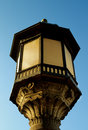 Obsolete lantern decorative street with forging details on blue sky background outdoors Stock Image