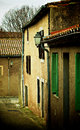 Obsolete street narrow with old houses and lanterns with view to corner of next outdoors Stock Images