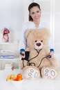 Occupation: Young female doctor with a teddy bear. Stock Image