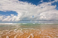 Ocean beach coastal seascape of a sunny blue waves and cloudy sky Stock Images