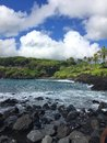 Black sand beach Ocean scene in maui hawaii Royalty Free Stock Photo