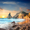 Ocean Landscape at Sundown time, beautiful rocks and stones beac Royalty Free Stock Photo