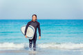 Ocean is my life a young surfer with his board on the beach Royalty Free Stock Images