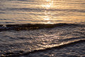 Ocean ripples at the sunset Royalty Free Stock Photo