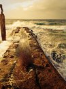 Ocean storm stormy seascape waves water pier scenic dangerous winter autumn Royalty Free Stock Photo