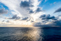 Ocean with sunbeam and clouds Royalty Free Stock Photo