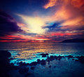 Ocean sunset vintage retro hipster style travel image of with great cloudscape Stock Photography