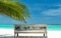Ocean view bank on the beach with to the turquoise indian Stock Photography