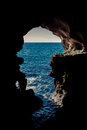 Ocean view through cave hole of the a large in the Stock Photography