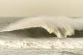 Ocean wave crashing black white vintage curling lip in contrast Stock Photos