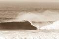 Ocean wave crashing sepia vintage curling lip in contrast Stock Images