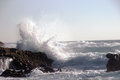 Ocean wave smashing against a rock in stormy with splash and foam Royalty Free Stock Images