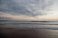 Ocean with waves and grey clouds Royalty Free Stock Photo
