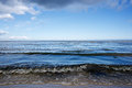 Ocean waves and very blue sky with some stormy clouds Royalty Free Stock Photo
