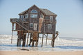 Oceanfront building lifted on the Royalty Free Stock Images