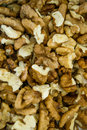 Ocher cracked pieces of walnuts texture - close up Royalty Free Stock Photo