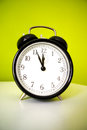 Oclock on the photo are with time five minutes to twelve Stock Photo