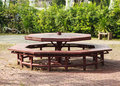 Octagonal picnic table weathered in the park Royalty Free Stock Images