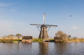 Octagonal thatched windmill in Kinderdijk Netherlands Royalty Free Stock Photo