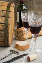 Octave and two wineglasses are on sacking bread Stock Images