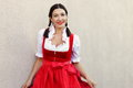 October fest concept.Beautiful german woman in typical oktoberfest dress dirndl Royalty Free Stock Photo