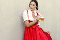 October fest concept.Beautiful german woman in typical oktoberfest dress dirndl holding a glass beer mug Royalty Free Stock Photo