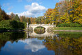 October on the river Slavyanka. Landscape with old by Viskontiev bridge in Pavlovsk Palace Park. Saint Petersburg Royalty Free Stock Photo