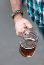 Octoberfest beer stein close up of a mans hand holding a of for shallow depth of field Stock Photos