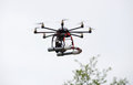 Octocopter flying an with camera Royalty Free Stock Photography