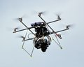 Octocopter flying an with camera in the air Royalty Free Stock Photography
