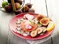 Octopus carpaccio over grapefruit Stock Images