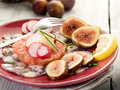 Octopus carpaccio over grapefruit Stock Photo