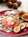 Octopus carpaccio over grapefruit Stock Photos