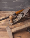 Od vintage hand tools on wooden background carpenter workplace tinted photo Stock Image