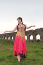 Odalisque belly dancer with ancient roman aqueducts ruins Royalty Free Stock Image