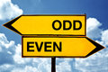 Odd or even opposite signs two against blue sky background Royalty Free Stock Images